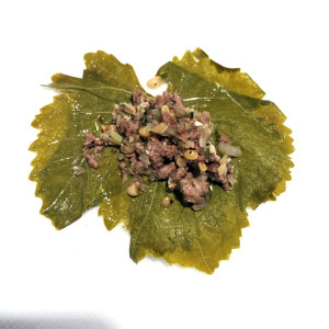 Meat mixture in grape leaf